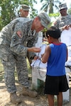 Army Sgt. 1st Class Eric Ritchey, a team leader with the 413th Civil Affairs Battalion, hands out school supplies to children at the Liberty Children's Home in Ladyville, Belize, April 18, 2017. Ritchey and other U.S. soldier participated in the community relations event as part of Beyond the Horizon 2017. The event is a partnership exercise between the government of Belize and U.S. Southern Command that will provide three free medical service events and five construction projects throughout the country of Belize from March 25 until June 17. Army photo by Staff Sgt. Fredrick Varney