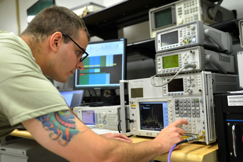 U.S. Air Force Staff Sgt. Timothy Miller, 20th Component Maintenance Squadron precision measurement equipment laboratory (PMEL) test measurement and diagnostic equipment craftsman, calibrates a power amplifier at Shaw Air Force Base, S.C., April 21, 2017. Airmen assigned to the 20th CMS PMEL flight adjust weaponry systems and hardware for space and ground-bound assets in support of the Air Force mission. (U.S. Air Force photo by Airman 1st Class Christopher Maldonado)