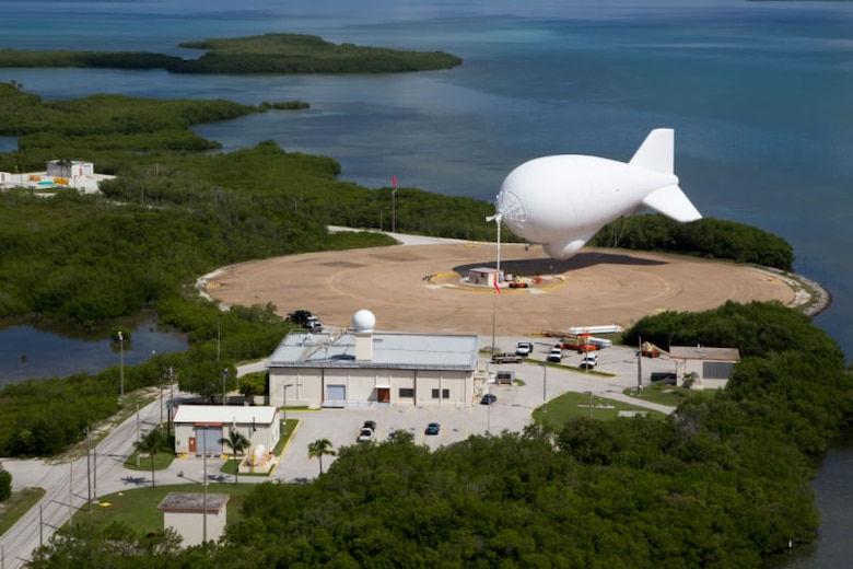 "A Tethered Aerostat Radar System (TARS), otherwise known as ""Fat Albert,"" sits on a platform at Cudjoe Key Air Force Station, Florida, circa 2014. Fat Albert is used in counter drug trafficking operation conducted by the U.S. border patrol, U.S. Customs, Homeland Security and the U.S. Coast Guard. (Courtesy photo by U.S. Customs and Border Protection)"