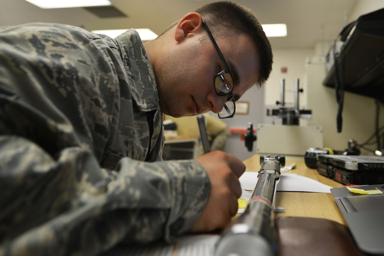 U.S. Air Force Airman 1st Class Paul Lippe, 20th Component Maintenance Squadron precision measurement equipment laboratory technician calibrates a torque wrench at Shaw Air Force Base, S.C., July 11, 2016. Lippe calibrated the torque wrench to ensure repairs made with it maintain Air Force standards. (U.S. Air Force photo by Airman 1st Class Christopher Maldonado)