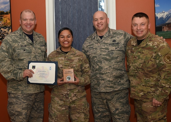 Senior Airman Marisa Martinez (second from left) supply and resources technician, with the 90th Missile Security Forces Squadron, poses for a photo accepting the Diamond Sharp award. Posing with Martinez from the left, are Col. Matthew Dillow, 90th Missile Wing vice commander, Chief Master Sgt. Jeffery Steagall, 90th Missile Wing command chief, Master Sgt. Brandon Finefrock, 90th Missile Security Forces Squadron first sergeant. The award is presented monthly to three Airmen chosen by the Warren First Sergeants council. (U.S. Air Force photo by Glenn Robertson)