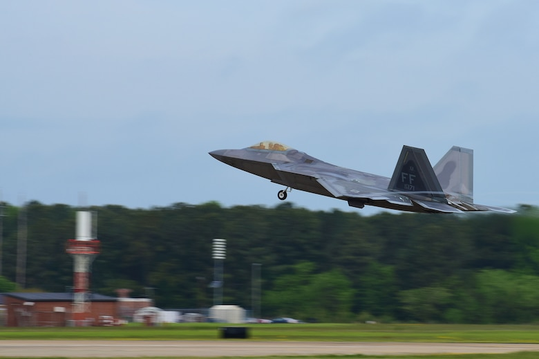 A U.S. Air Force F-22 Raptor takes off during ATLANTIC TRIDENT 17 at Joint Base Langley-Eustis, Va., April 20, 2017. This exercise provides Airmen and international partners an opportunity to experience realistic combat scenarios that enhance their ability to effectively fight together in today's environments. (U.S. Air Force Photo/Airman 1st Class Tristan Biese)