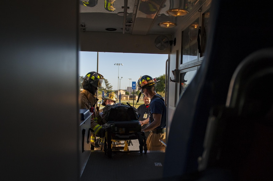 Moody firefighters lift a stimulated victim into an ambulance, April 19, 2017, at Moody Air Force Base, Ga. The exercise tested the wing's ability to evacuate aircraft, secure assets and respond to emergency situations in the event of a real-world natural disaster. (U.S. Air Force photo by Airman 1st Class Lauren M. Sprunk)