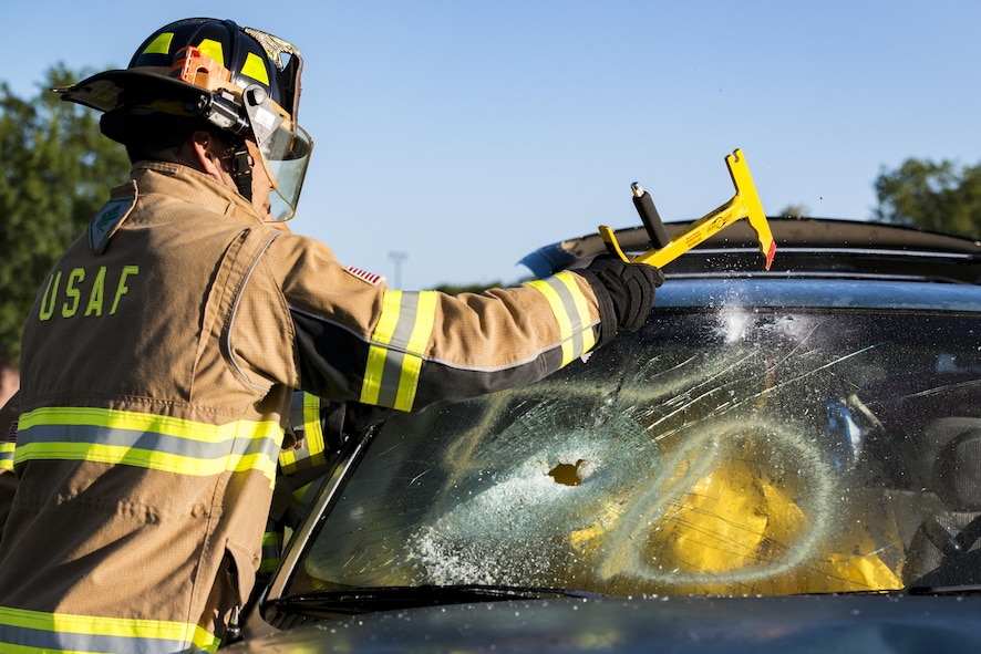 Matthew Perreira, 23d Civil Engineering Squadron firefighter, breaks a windshield during a natural disaster exercise, April 19, 2017, at Moody Air Force Base, Ga. The exercise tested the wing's ability to evacuate aircraft, secure assets and respond to emergency situations in the event of a real-world natural disaster. (U.S. Air Force photo by Airman 1st Class Lauren M. Sprunk)
