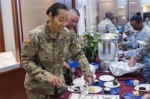 Chief Warrant Officer 3 Ericka Morales, with the U.S. Army Reserve Command protocol office, serves cake to Soldiers and civilians at Fort Bragg, N.C., April 21, 2017, as they celebrate the 109th anniversary of the of the U.S. Army Reserve. Created in 1908 as the Medical Reserve Corps, America's Army Reserve of today has transformed into a capable, combat-ready, and lethal Federal reserve force in support of the Army at home and abroad. (U.S. Army Reserve photo by Timothy L. Hale)(Released)