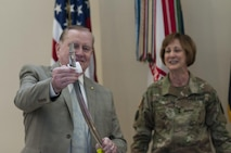 Rexford Davis, with the U.S. Army Reserve Command G-3/5/7, wipes cake off the ceremonial saber as Maj. Gen. Megan P. Tatu, U.S. Army Reserve Command chief of staff, looks on at the USARC headquarters, April 21, 2017, at Fort Bragg, N.C. Soldiers and civilians at the headquarters celebrated the 109th anniversary of the of the U.S. Army Reserve. Created in 1908 as the Medical Reserve Corps, America's Army Reserve of today has transformed into a capable, combat-ready, and lethal Federal reserve force in support of the Army at home and abroad. (U.S. Army Reserve photo by Timothy L. Hale)(Released)