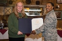 Lt. Col. Tiaundra Moncrief, 90th Missile Wing Legal Office staff judge advocate, presents Elaine Hart, 90th MW Legal Office recorder, with a Certificate of Service during her retirement ceremony at F.E. Warren Air Force Base, Wyo., April 21, 2017. The Certificate of Service is to recognize Hart's 45 years of federal civilian service. (U.S. Air Force photo by Staff Sgt. Christopher Ruano)