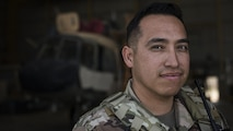 Tech. Sgt. Hector Flores, 738th Air Expeditionary Advisory Group guardian angel, poses for a photo.  His unit provided armed overwatch for contractors and air advisors performing maintenance on an Afghan Air Force Mi-17 Military Transport Helicopter April 16, 2017, at Kandahar Air Wing, Afghanistan. Flores is deployed with other Citizen Airmen from the 507th Security Forces Squadron, Tinker Air Force Base, Okla. (U.S. Air Force photo/Staff Sgt. Katherine Spessa)