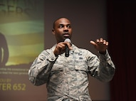 Tech. Sgt. Glenn Davis, 335th Training Squadron personnel apprentice course NCO in charge, welcomes Airmen from the 81st Training Group to the Airmen Building Airmen Symposium at the Welch Theater April 21, 2017, on Keesler Air Force Base, Miss. The Air Force Sergeants Association Chapter 652, sponsored the event designed to inspire young Airmen and help them develop their leadership skills.  (U.S. Air Force photo by Kemberly Groue)