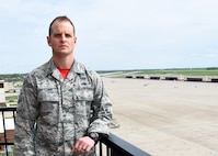 Tech Sgt. Patrick Hatcher stands with the Whiteman Air Force Base, Missouri, flight line in the background, April 21, 2017. Hatcher, the occupational safety manager for the Missouri Air National Guard's 131st Bomb Wing, was recently selected for the prestigious 2016 Air National Guard Individual Ground Safety Award. (U.S. Air National Guard photo by Senior Master Sgt. Mary-Dale Amison
