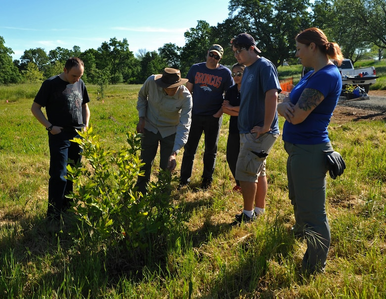 Chadwick McCready, 9th Civil Engineer Squadron biologist teaches a group of volunteers facts about native tree species April 21, 2017 at Beale Air Force Base, California. The group planted 16 seedlings and saplings. (U.S. Air Force photo/Airman 1st Class Tristan D. Viglianco)