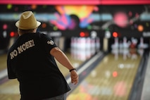 Ann McCarty, North County Rape Crisis and Child Protection Center executive director, rolls a bowling ball down the lane during a bowling event, April 21, 2017, Vandenberg Air Force Base, Calif. The event, hosted by the Sexual Assault Prevention and Response office, was designed to increase awareness and support during Sexual Assault Awareness and Prevention Month, which is nationally recognized in April. (U.S. Air Force photo by Senior Airman Robert J. Volio/Released)