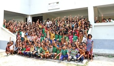 Managed by the U.S. Army Corps of Engineers – Alaska District's Asia Office, final construction operations are wrapping up the three-year Multipurpose Cyclone Shelter and School Program with the financial assistance from U.S. Agency for International Development. Shown here, students show their school spirit at one of the newly constructed facilities.