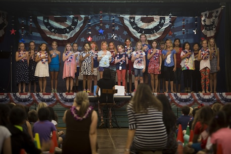 "Students at Aikahi Elementary School pledge allegiance to the U.S. flag during a Yellow Ribbon Day celebration on April 7, 2017.  Yellow Ribbon Day is part of April's ""Month of the Military Child,"" which acknowledges and honors the sacrifices made by children with parents in the armed services. (U.S. Marine Corps photo by Lance Cpl. Matthew Kirk)"
