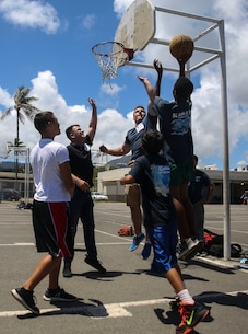 "KAILUA, Hawaii – Marines with Headquarters Battalion, Marine Corps Base Hawaii, play basketball with students at Kailua Intermediate School, April 12, 2017. Marines gave back to their community by volunteering at KIS for the school's ""Wednesday Volunteer Program."" The program provides Marines the opportunity to interact with students, assist teachers around the classroom, and be positive role models for the children. (U.S. Marine Corps Photo by Cpl. Jesus Sepulveda Torres)"