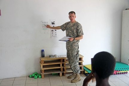 Lt. Col. Peter Stewart, a case management nurse with the Utah Medical Command, conducts an eye exam for a young patient at Liberty Children's Home April 18, 2017, during a community relations event held in Ladyville, Belize as part of Beyond the Horizon 2017.  BTH 2017 is a U.S. Southern Command-sponsored, Army South-led exercise designed to provide humanitarian and engineering services to communities in need, demonstrating U.S. support for Belize.(U.S. Army Photo by Staff Sgt. Fredrick Varney)
