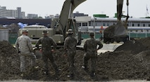 U.S. and Republic of Korea Airmen watch an excavator during the U.S./ROK Combined Airfield Damage Repair Exercise at Daegu Air Base, April 18, 2017. For five days, U.S. and ROK Airmen repaired damaged runway sections while sharing techniques, strengthening bonds and forging friendships between the two allied countries. (U.S. Air Force photo by Staff Sgt. Alex Fox Echols III)