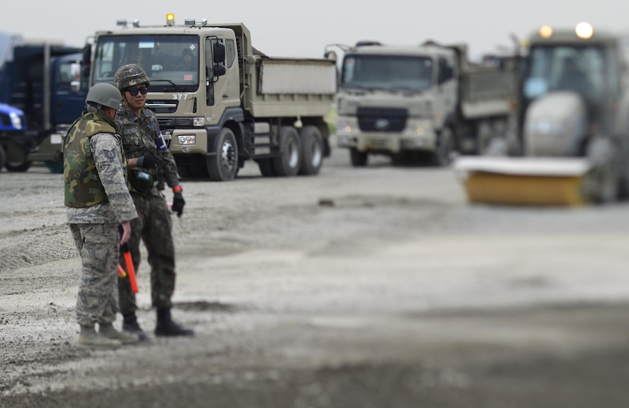 Republic of Korea Air Force Staff Sgt. Choi Seoung-bin, 11th Fighter Wing NCOIC equipment operations, speaks with U.S. Air Force Tech. Sgt. Travis Ridgley, 647th Civil Engineer Squadron crater chief, during the U.S./ROK Combined Airfield Damage Repair Exercise at Daegu Air Base, April 20, 2017. The annual exercise ensures seamless interoperability between the U.S. and ROK while conducting airfield damage repair and improves their capability and commitment to work together at a moment's notice. (U.S. Air Force photo by Staff Sgt. Alex Fox Echols III)