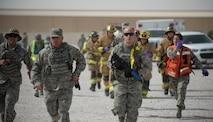 First responders from 379th Expeditionary Air Expeditionary Wing run to the scene of the active shooter exercise in order to administer medical treatment to victims at Al Udeid Air Base, Qatar, April 17, 2017. The active shooter exercise tested the skills and abilities of Airmen to work with other units in in order to gain a better understanding of each other's roles in the event of a real-world situation.   (U.S. Air Force photo by Tech. Sgt. Amy M. Lovgren)