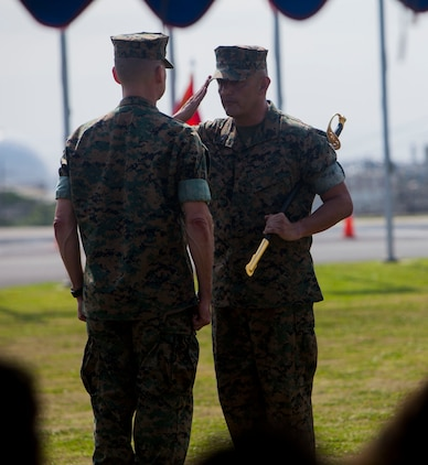 Sgt. Maj. Mario A. Marquez turns over the sword of office to Maj. Gen. Russell A. Sanborn during a relief and appointment ceremony on Camp Foster, Okinawa, Japan, April 21, 2017. Relief and appointment ceremonies are part of the Marine Corps' tradition in passing leadership from one to another. During the ceremony, Sgt. Maj. Michael J. Pritchard, from Keene, New Hampshire, was appointed sergeant major of 1st Marine Aircraft Wing, III Marine Expeditionary Force. Marquez, from Lakewood, California, was the previous sergeant major of 1st MAW. Sanborn, from Gainesville, Florida, is the commanding general of 1st MAW. (U.S. Marine Corps photo by Lance Cpl. Jonah Baase)