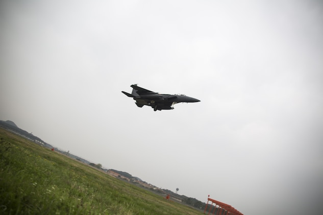A Republic of Korea F-15K Slam Eagle descends to land on the runway after concluding a defensive counter air mission during Exercise MAX THUNDER 17 at Kunsan Air Base, ROK, April 18, 2017. Max Thunder serves as an opportunity for U.S. and ROK forces to train together and sharpen tactical skills for the defense of the Asia-Pacific region. It is an annual military-flying exercise built to promote interoperability between U.S. and ROK forces. (U.S. Marine Corps photo by Lance Cpl. Carlos Jimenez)