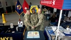 Brig. Gen. Steven Ainsworth, left, Command Sgt. Maj. Raymond Brown, right, and Spc. Jonathan Boyden, center, pose after cutting the Army Reserve birthday cake Friday, April 21 at the Kaiserslautern Military Community Center on Ramstein Air Base. The afternoon event was organized by the 7th Mission Support Command to celebrate the 109th Army Reserve birthday.