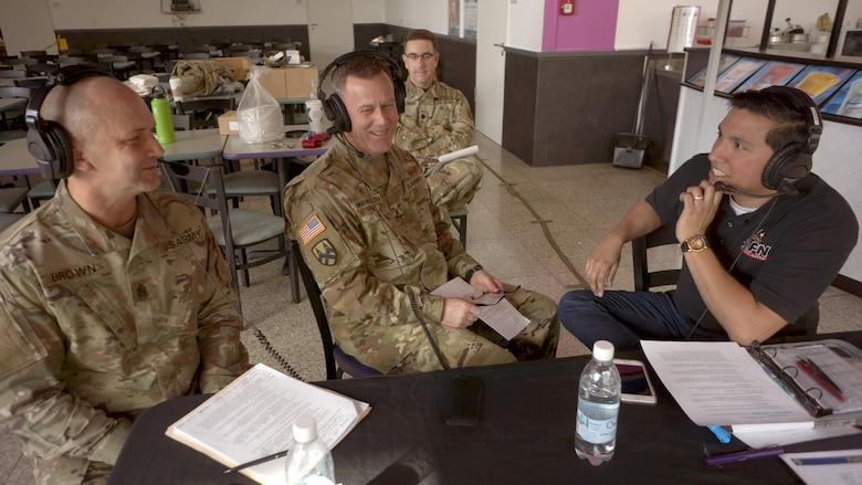 """Command Sgt. Maj. Raymond Brown, left, and Brig. Gen. Steven Ainsworth, center, command team for the Army Reserve's 7th Mission Support Command, speak on the air with AFN radio host Sgt. Jose """"Dan the Man"""" Ramirez Friday, April 21 at the Kaiserslautern Military Community Center on Ramstein Air Base. The afternoon event celebrated the 109th Army Reserve birthday."""