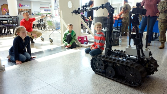 Children and adults enjoy the 773rd Civil Support Team's surveying robots Friday, April 21 at the Kaiserslautern Military Community Center on Ramstein Air Base. The afternoon event was organized by the 7th Mission Support Command to celebrate the 109th Army Reserve birthday.