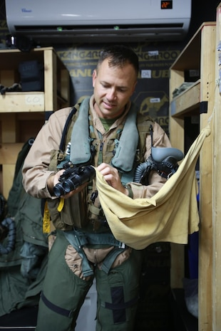 U.S. Marine Corps Maj. Trevor Felter, executive officer and AV-8B Harrier pilot deployed in support of Combined Joint Task Force – Operation Inherent Resolve, assigned to  Marine Attack Squadron 231, Special Purpose Marine Air-Ground Task Force-Crisis Response-Central Command, conducts a pre-flight check of his safety survival equipment, Feb. 28, 2017. SPMAGTF-CR-CC continues its commitment to support OIR and USCENTCOM through employment of kinetic air strike missions, security cooperation and crisis response assets within the region. CJTF-OIR is the global Coalition to defeat ISIS in Iraq and Syria. (U.S. Marine Corps photo by Staff Sgt. Jennifer B. Poole)