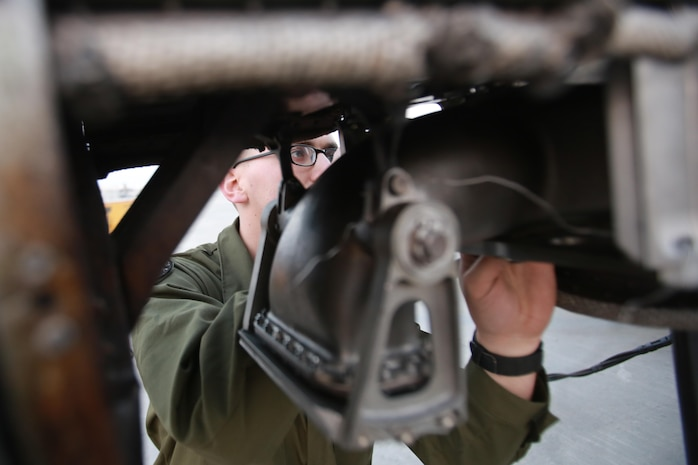 U.S. Marine Corps Cpl. Jacob Miller, an airframes mechanic deployed in support of Combined Joint Task Force – Operation Inherent Resolve, assigned to Marine Attack Squadron 231, Special Purpose Marine Air-Ground Task Force-Crisis Response-Central Command, conducts a pre-flight check on an AV-8B Harrier, March 2, 2017. SPMAGTF-CR-CC continues its commitment to support OIR and USCENTCOM through employment of kinetic air strike missions, security cooperation and crisis response assets within the region. CJTF-OIR is the global Coalition to defeat ISIS in Iraq and Syria. (U.S. Marine Corps photo by  Staff Sgt. Jennifer B. Poole)