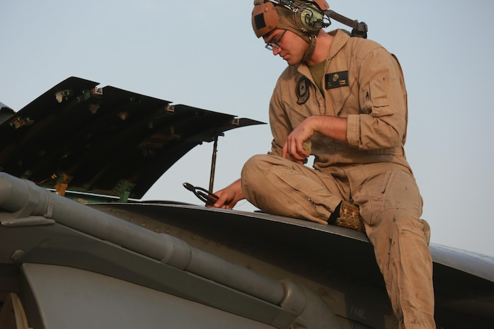 U.S. Marine Corps Lance Cpl. Tyler Summ, a fixed wing aircraft mechanic deployed in support of Combined Joint Task Force – Operation Inherent Resolve, assigned to  Marine Attack Squadron 231, Special Purpose Marine Air-Ground Task Force-Crisis Response-Central Command, conducts a pre-flight maintenance check, March 2, 2017. SPMAGTF-CR-CC continues its commitment to support OIR and USCENTCOM through employment of kinetic air strike missions, security cooperation and crisis response assets within the region. CJTF-OIR is the global Coalition to defeat ISIS in Iraq and Syria. (U.S. Marine Corps photo by Staff Sgt. Jennifer B. Poole)