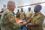 Army Brig. Gen. Kenneth Moore, deputy commander of U.S. Army Africa, shakes hands with Malawi Gen. Griffin Phiri, chief of the Malawi Armed Forces, after a briefing at the Kumuzu Barracks, Lilongwe, Malawi, during the final planning event for the Africa Land Forces Summit 2017. The summit is an annual seminar bringing together land force chiefs from across Africa to discuss and develop cooperative solutions to regional and trans-regional challenges and threats. Army photo by Capt. Jason Welch