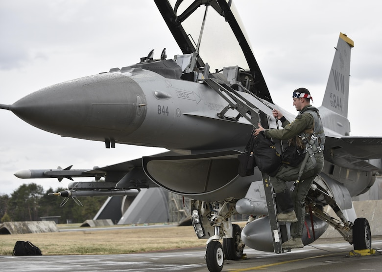 U.S. Air Force Capt. Dakota Newton, a 14th Fighter Squadron standards and evaluations liaison officer, climbs a ladder to the cockpit of an F-16 Fighting Falcon prior to the start of a bilateral exercise at Misawa Air Base, April 19, 2017. Exercises such as this enhance inoperability between the Air Force and Japan Air Self-Defense Forces and showcase the long standing military partnership and commitment between the two nations ensuring security and stability throughout the Indo Asia Pacific region. (U.S. Air Force photo by Staff Sgt. Melanie A. Hutto)