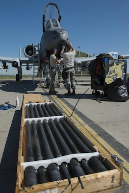 U.S. Air Force Staff Sgt. Stephans Doherty (left) and Senior Airman Nathaniel Awrey, both 447th Expeditionary Aircraft Maintenance Squadron aircraft armament systems journeyman, reassemble an A-10 Thunderbolt II GAU-8/A Avenger rotary cannon April 5, 2017, at Incirlik Air Base, Turkey. The seven barrels are inspected to ensure functionality and are replaced after 30 thousand rounds are fired through them. (U.S. Air Force photo by Airman 1st Class Devin M. Rumbaugh)