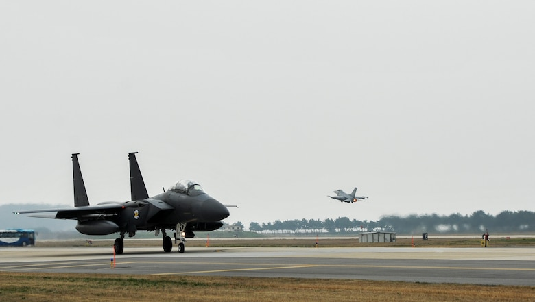 A Republic of Korea Air Force F-15K Slam Eagles from the 11th Fighter Squadron, Daegu Air Base, ROK, taxis down the flightline while an F-16 Fighting Falcon from the 35th Fighter Squadron takes off during Exercise MAX THUNDER 17 at Kunsan Air Base, Republic of Korea, April 18, 2017. In Max Thunder, U.S. and ROK air forces consistently train together to be ready around-the-clock to defend the Republic of Korea. The interoperability and trust developed between the allies in training is critical to ensure we are prepared for any challenge. (U.S. Air Force photo by Senior Airman Colville McFee/Released)