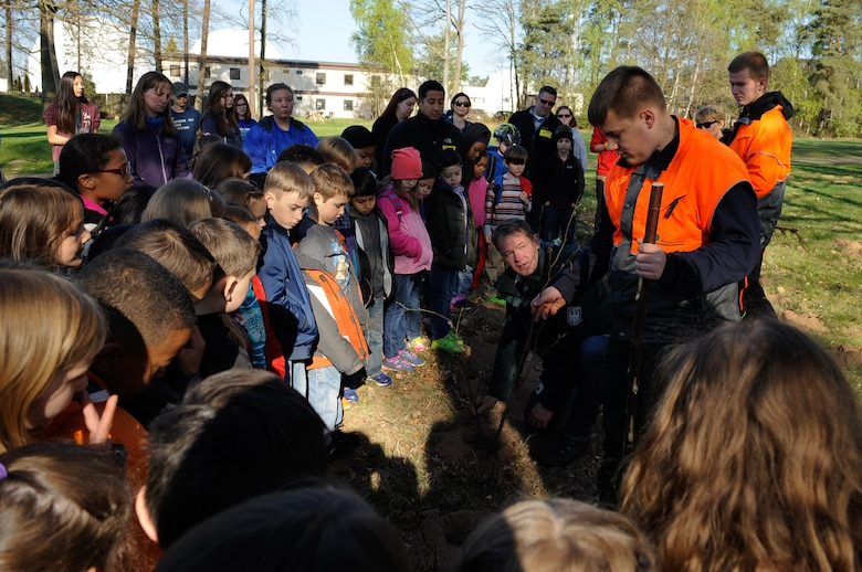 Federal forest departments show students from the Kaiserslautern Military Community the correct way to plant a tree during an Earth Day tree planting celebration on Ramstein Air Base, Germany, April 21, 2017. Students celebrated Earth Day, demonstrating support for environmental protection by planting trees. (U.S. Air Force photo by Airman 1st Class Savannah L. Waters)