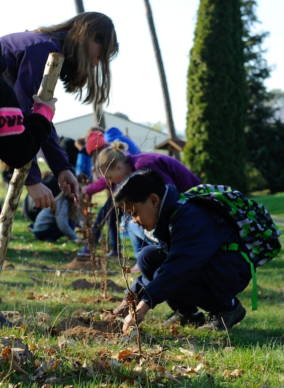 Kaiserslautern Military Community students plant trees in celebration of Earth Day on Ramstein Air Base, Germany, April 21, 2017. This year, more than 85 students and teachers helped plant more than 1,500 trees. (U.S. Air Force photo by Airman 1st Class Savannah L. Waters)