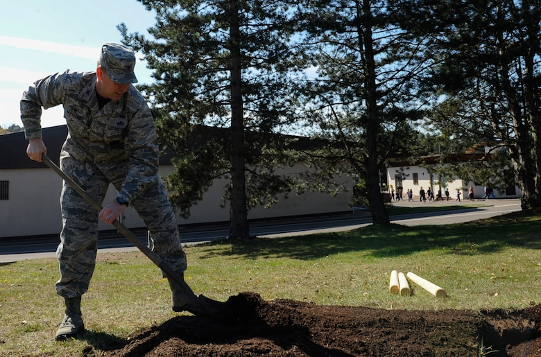 Col. Brian Hartless, 86th Civil Engineer Group commander, shovels dirt to plant a tree on Ramstein Air Base, Germany, April 21, 2017. The 86th CEG leadership and federal forest departments planted trees to celebrate Earth Day and raise awareness for environmental protection. (U.S. Air Force photo by Airman 1st Class Savannah L. Waters)