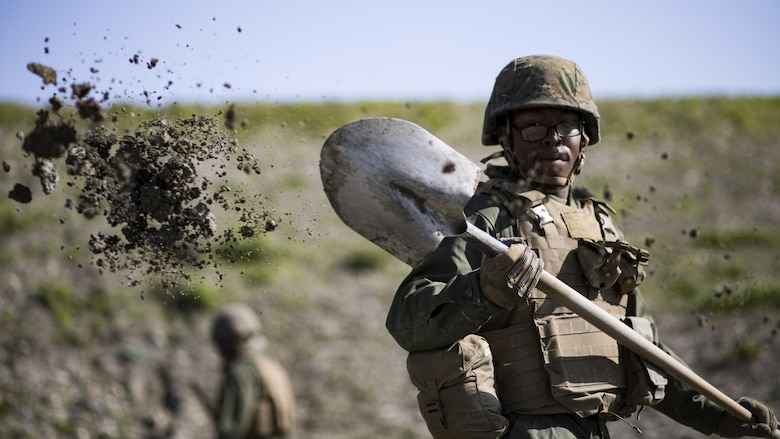 U.S. Marine Corps Pfc. Jason Taylor, a combat engineer with Marine Wing Support Squadron 171, shovels dirt and mud during airfield damage and repair training at Marine Corps Air Station Iwakuni, Japan, April 19, 2017. The ADR training required Marines to utilize their skill set to tactically and proficiently fix any anomalies to a simulated damaged airfield. The training focused on becoming more efficient in situations that may require Marines to act in real-world scenarios to maintain the tempo of aircraft operations.