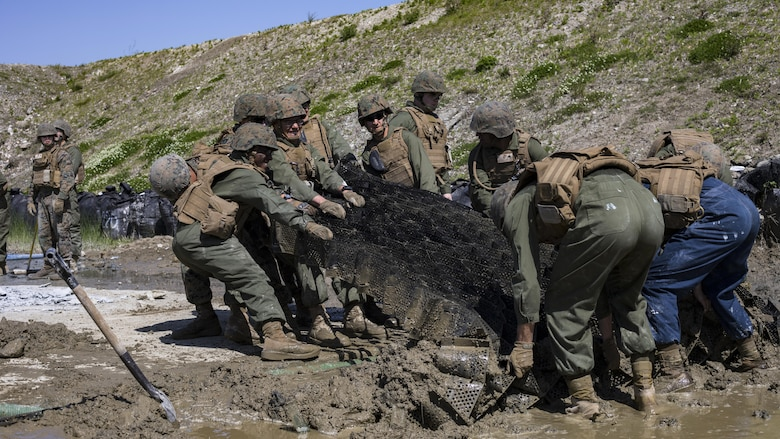 U.S. Marines with Marine Wing Support Squadron 171, prepare a simulated crater in the runway for repair during airfield damage and repair training at Marine Corps Air Station Iwakuni, Japan, April 19, 2017. The ADR training required Marines to utilize their skill set to tactically and proficiently fix any anomalies to a simulated damaged airfield. The training focused on becoming more efficient in situations that may require Marines to act in real-world scenarios to maintain the tempo of aircraft operations.