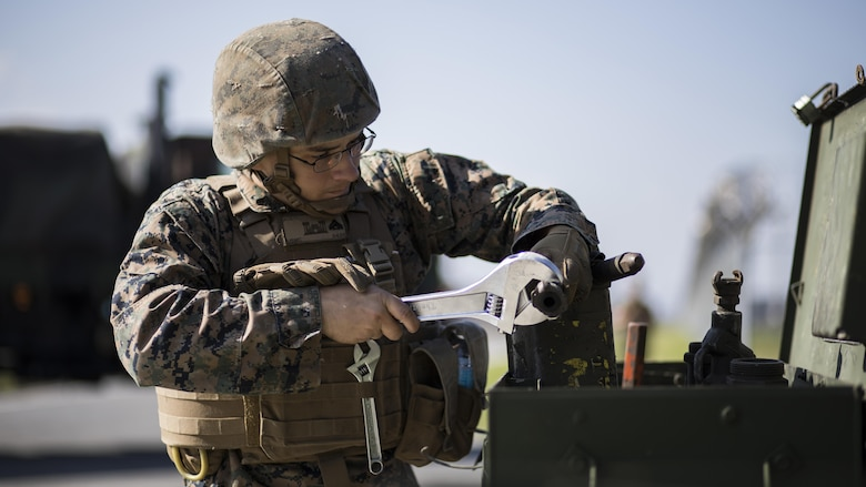 U.S. Marine Corps Cpl. Jeffrey Aceti, a combat engineer with Marine Wing Support Squadron 171, maintains equipment used during airfield damage and repair training at Marine Corps Air Station Iwakuni, Japan, April 19, 2017. The ADR training required Marines to utilize their skill set to tactically and proficiently fix any anomalies to a simulated damaged airfield. The training focused on becoming more efficient in situations that may require Marines to act in real-world scenarios to maintain the tempo of aircraft operations.
