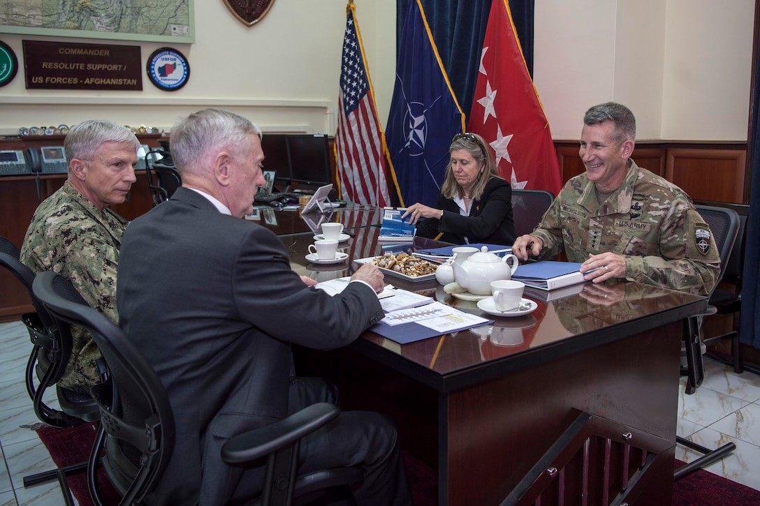 Defense Secretary Jim Mattis meets with Army Gen. John W. Nicholson Jr., right, commander of NATO's Resolute Support mission.