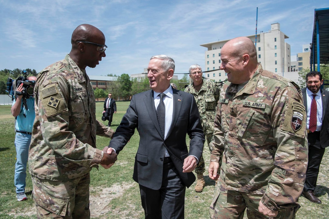Defense Secretary Jim Mattis greets Army Command Sgt. Maj. David Clark, left, Resolute Support senior enlisted leader, and Army Maj. Gen. Christopher Haas, Resolute Support deputy chief of staff for operations.