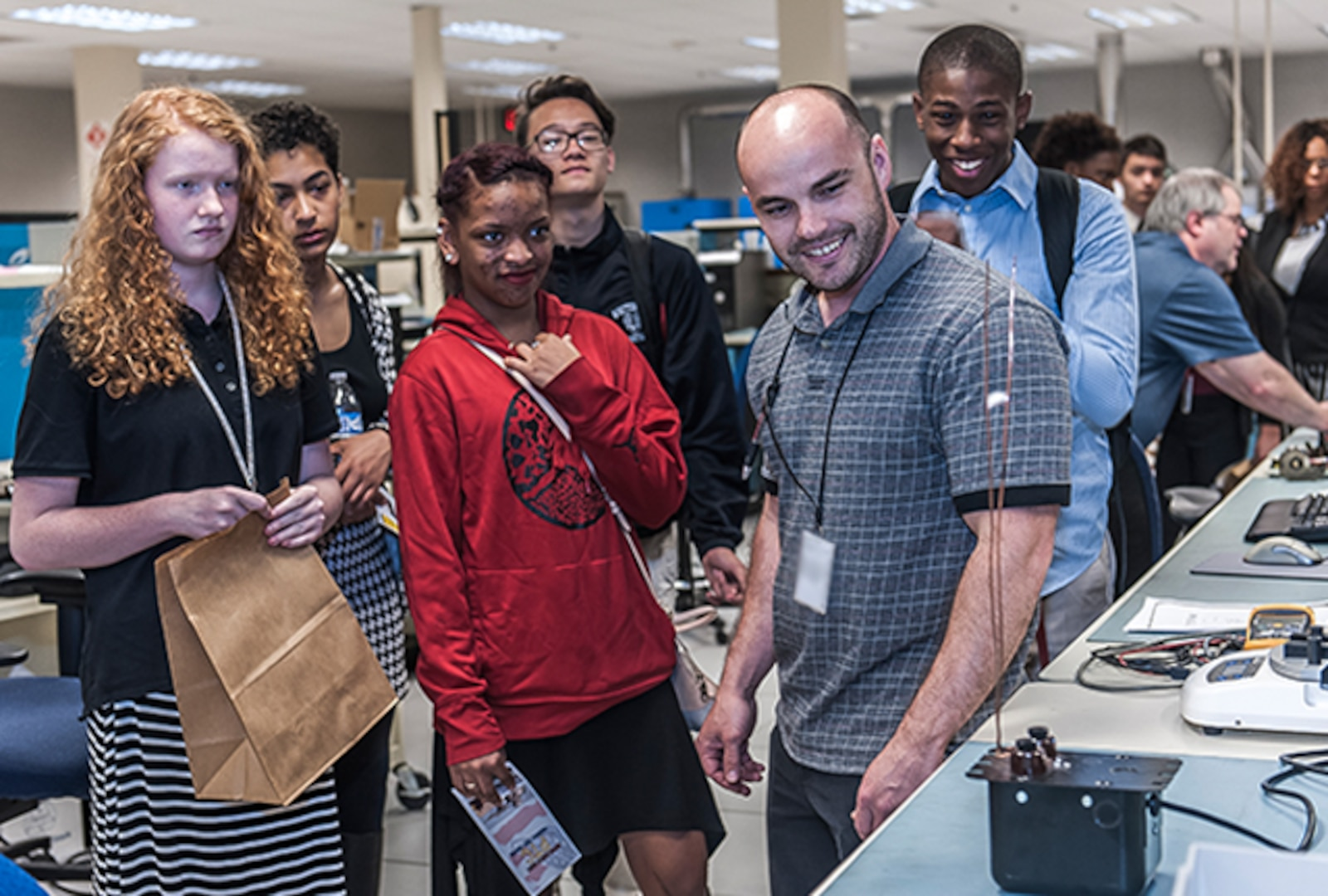 """Whitehall-Yearling students visit the test lab at Defense Supply Center Columbus and recieve hands on training during """"A day in the life of a mentor"""" event on Apr. 20."""