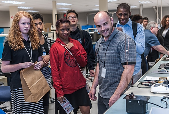"Whitehall-Yearling students visit the test lab at Defense Supply Center Columbus and recieve hands on training during ""A day in the life of a mentor"" event on Apr. 20."