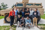 "Local high school students learn about the types of military equipment DLA purchases to support warfighters around the world during a visit to Defense Supply Center Columbus for ""A day in the life of a mentor"" event on Apr. 20."