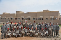 Members of the Saudi Arabia Ministry of Defense Military Police pose for a photo during graduation from a three-week training exercise with the 879th Expeditionary Security Forces Squadron at Eskan Village, Kingdom of Saudi Arabia, March 2, 2017. Airmen and Saudi police members trained in multiple areas of security protection, including: formations for escorting, identifying explosives and vehicle searches.  (Courtesy photo)