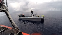 Boarding team members from the Coast Guard Cutter Mohawk interdict suspected smugglers in the Eastern Pacific in February, 2017. (US Coast Guard photo)
