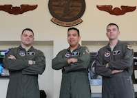 U.S. Air Force Tech. Sgt. Mike, Master Sgt. Alex and Master Sgt. Mike will become the first Enlisted Pilot Initial Class students to graduate from Undergraduate Remotely Piloted Aircraft Training at Joint Base San Antonio-Randolph, Texas, on May 5, 2017. These EPIC students are integrated with commissioned officer students assigned to URT Class 17-10, at the 558th Flying Training Squadron. Name badges were blurred due to Air Force limits on disclosure of identifying information for RPA operators. (U.S. Air Force illustration by  Tech. Sgt. Ave I. Young)