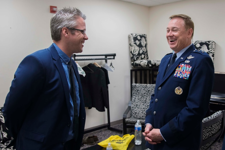 Marshall Gilkes, left, guest jazz trombonist, laughs during a meet and greet with Maj. Gen. Darryl W. Burke, right, Air Force District of Washington and 320th Air Expeditionary Wing commander, in Alexandria, Va., April 20, 2017. Gilkes was one of three artist to perform in the Airmen of Note's Jazz Heritage Series. The U.S. Air Force Band first established the annual series in 1990, which features bandsmen with renowned jazz icons. (U.S. Air Force photo by Airman 1st Class Valentina Lopez)